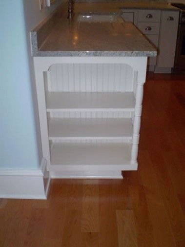 Use the side end of a cupboard for built-in bookcase.