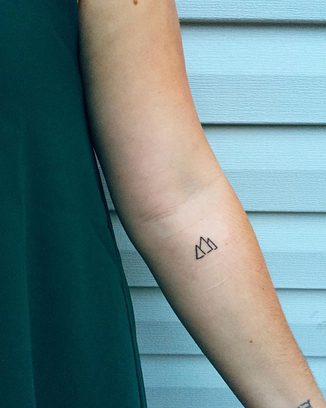 ≫ No better way to get an early start on my birthday than with a new tattoo, right? I created this simple design of three connected - yet not fully complete - triangles and it is so, so special to me. Here's why: » Superficially, the triangles resemble mountains, which are basically my love language. Growing up in Northern California, I spent almost every summer in the mountains, and if given the choice, I will always choose mountains over the beach. The way they put God's glory on display…