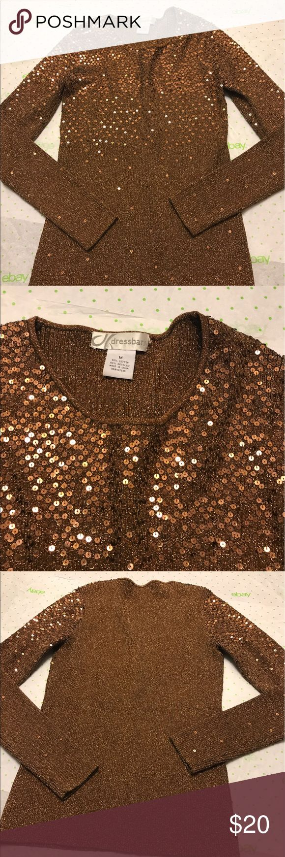 "Dressbarn Bronze Sequin long sleeve shirt Sz M NWOT Dressbarn Women's Bronze Sequin Cotton Metallic Shirt Size Medium New  New without tags 60% cotton 40% Metallic Stretchy Pit to pit 15"" Waist 13"" across Sleeves 26"" collar to end Length 23"" Dress Barn Tops"