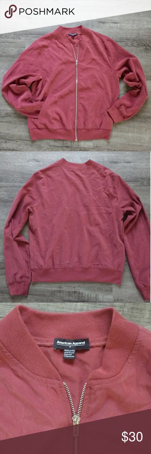 American Apparel Zip-Up Top Uber soft and in good used condition, this lightweight zip-up jacket is ready to make your spring wardrobe pop.  It's a bomber jacket cut with super light 72% modal and 28% polyester fabric.  DRY CLEAN ONLY American Apparel Jackets & Coats