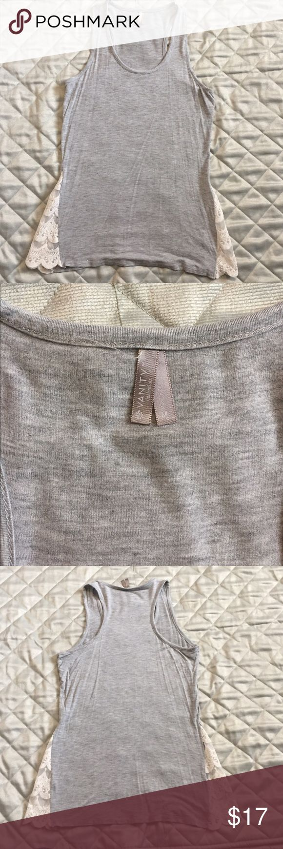 NWOT Vanity Razorback Tank NWOT Vanity razorback gray tee with cream lace on the side bottoms as pictured.  This comes past your hips. Very soft.  95% Rayon and 5% Spandex is the gray part and 80% cotton and 20% polyester for the trim. Vanity Tops Tank Tops