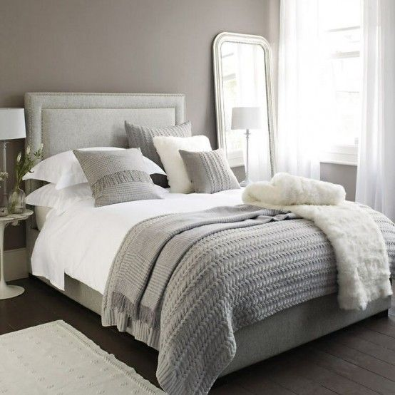 Romantic neutral bedroom with soft textures. Neutral colors do not have the following white color selection on the gray room with wooden floors and soft mattress colors and a large deco...