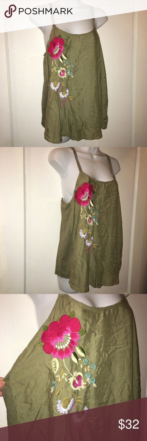 Akemi + Kin Army Green Cami Tank Embroidered Sz M Akemi + Kin Army Green Cami Tank Embroidered Sz M  Soft army green with beautiful floral embroidery.   Anthropologie Brand Akemi + Kin  Sz M  Adorable double straps  Hangs really neat. Fabric on front is a bit different from fabric on back.  Would be great with some high waisted jeans shorts for a summer or spring music festival Anthropologie Tops Camisoles