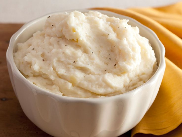 Creamy Garlic Mashed Potatoes recipe from Alton Brown via Food Network to do home style do half waxy and half russet.