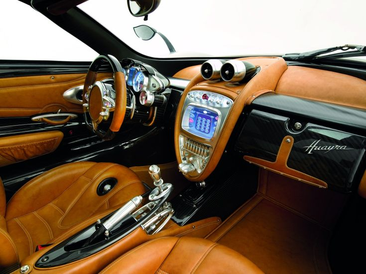 Pagani Huayra interior. Aside from that weird bidet looking thing in the seat, I think this is a great looking interior (and even that's kinda neat...whatever it is). Check out that stick shift.