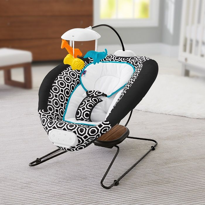 Jonathan Adler Crafted by Fisher-Price Deluxe Bouncer -- This contemporary, high-performing bouncer seat combines deluxe style, fun music, soothing sounds, and enhanced bouncing performance, so your baby can relax in luxurious comfort. From play time to nap time, this stylish bouncer has everything your little one could desire. And, with a removable and machine-washable insert and seat pad, cleanup is a breeze!