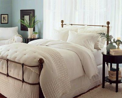 It looks so comfy! I don't think I'd ever get out of bed!  Ivory bedding with burlap skirt