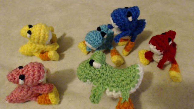 Tiny baby Yoshi amigurumi plush. This cute little doll measures about 3 inches long from nose to tail. I have a full video tutorial available on my Youtube channel. You can find that here: