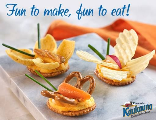 Spread Kaukauna on small round crackers. Use pretzel twists, crinkled potato chips or corn chips for the wings. The body is made from a baby carrot, pretzel stick, or apple slice. Add herbs for the antennae.