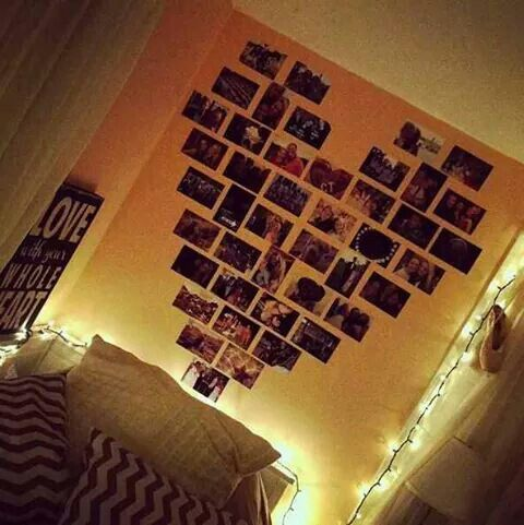 DIY pictures arranged into a heart. It looks so pretty with the fairy lights around the wall.