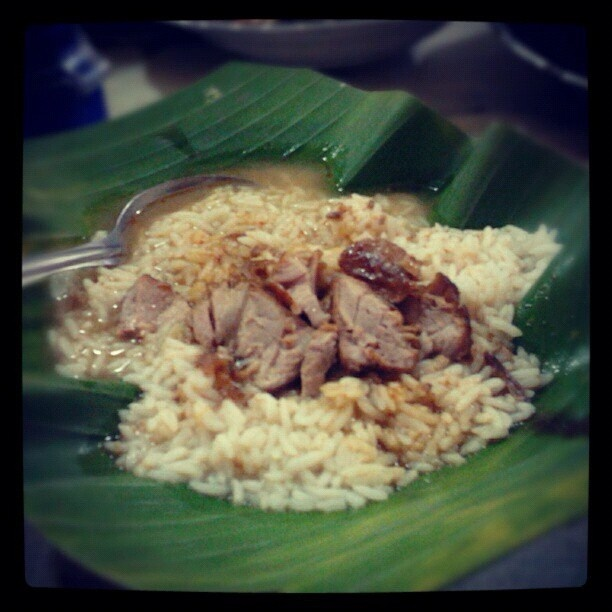 Nasi gandul - Traditional food in Pati, Central Java. Served with curry and ketchup and always accompanied with meat slices, chicken slices, or eggs.