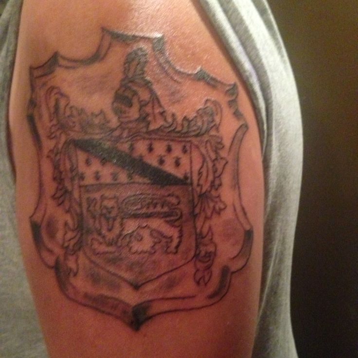 Done on son, father's tattoo of family crest