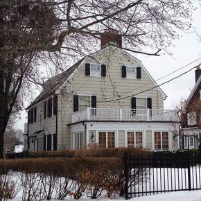 The Amityville Horror house in Amityville,  NY.  Even though they say this was a hoax,  I read the book and saw the movie when I was about 11 and it still gives me the creeps.  I could never have those quarter moon windows like the house used to have just because of the book and movie! It would totally creep me out.  Regardless if the haunting is true,  the murders are enough for me to be scared of it.