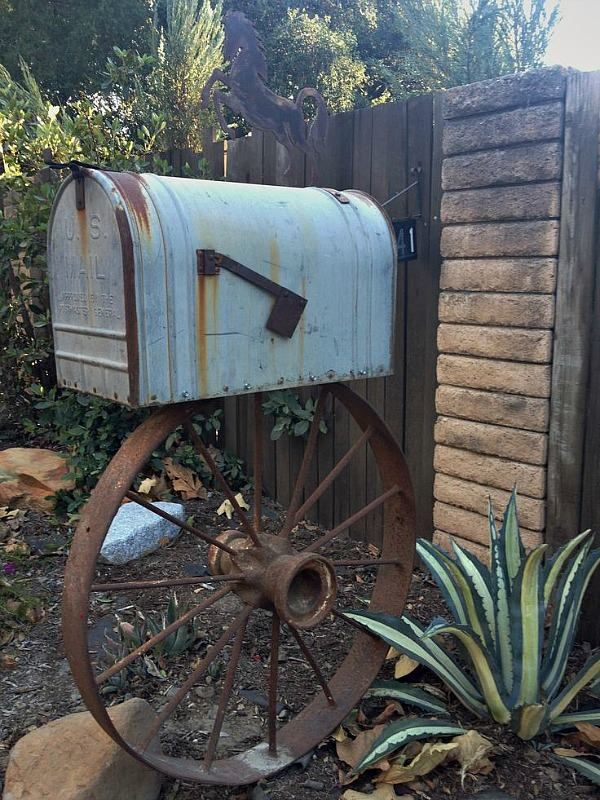 I could see this with a climbing plant growing on the wheel with a nice place for my garden utensils and supplies inside the mailbox. lhttps://scontent-b-sjc.xx.fbcdn.net/hphotos-prn1/t1/1545799_10152213641340070_63499802_n.jpg