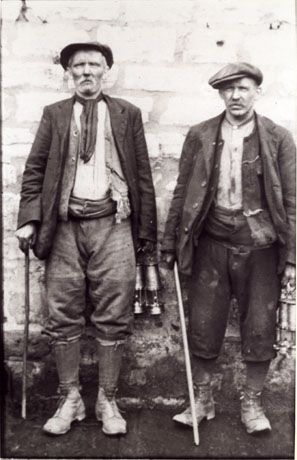 1900 work clothes | wall; both men are middle-aged and are dressed in work clothes ...