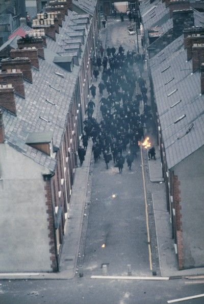 Troops of the Royal Ulster Constabulary enter the Catholic neighbourhood called Bogside in the Battle of the Bogside.Belfast, Northern Ireland ca. 1969 Derry/Londonderry, Northern Ireland August (1969) by Akihiko Okamura