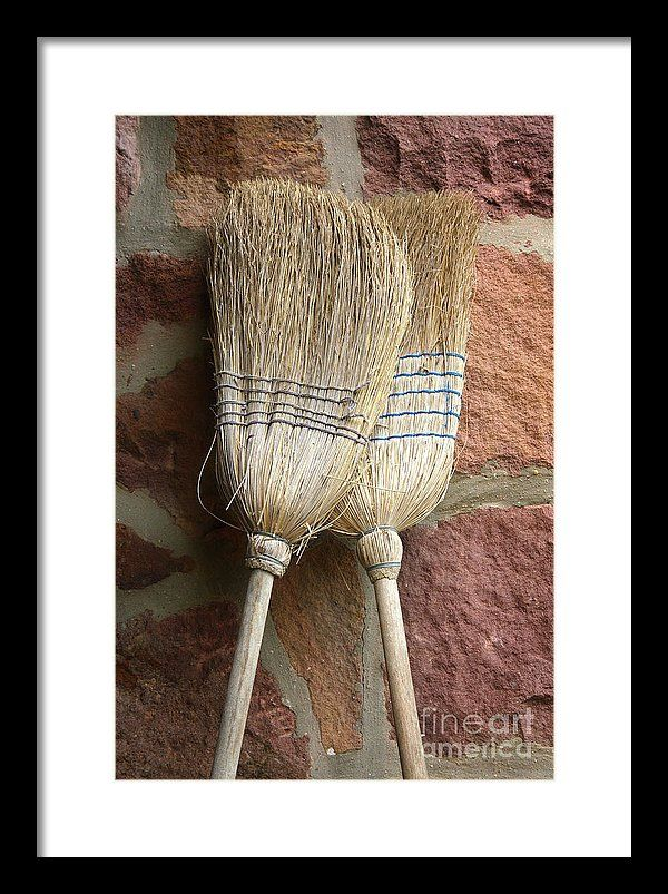 Rough Framed Print featuring the photograph Straw Brooms In Love by Jan Brons. Straw brooms in love.     Two straw brooms in love. They could stand upright against the stone wall all day long. The cemented rock wall wouldn't care at all if they would just hang around. At least something happens.