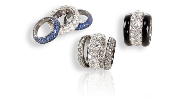 """""""Profumo di Diamanti"""" Collection: Eternity ring in white gold with diamonds and eternity rings in blue sapphires; eternity ring in white gold with diamonds and eternity rings in gray diamonds; eternity ring in white gold with diamonds and eternity rings in black enamel."""