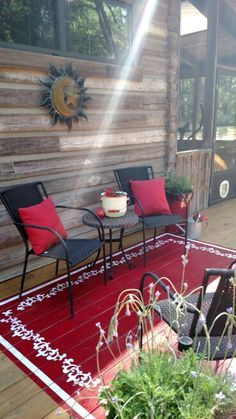 """I opted to paint an area rug on the sun deck.  I simply painted a red square, then stenciled white with painters tape and a 12"""" stencil.  Super easy!!"""