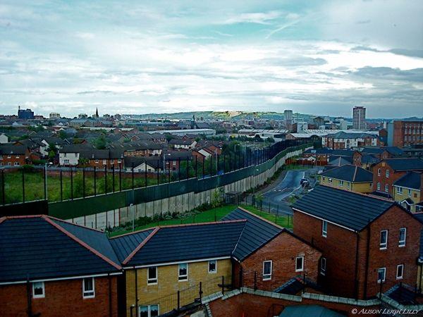 Belfast, Northern Ireland: The wall separating Catholic and Protestant neighborhoods