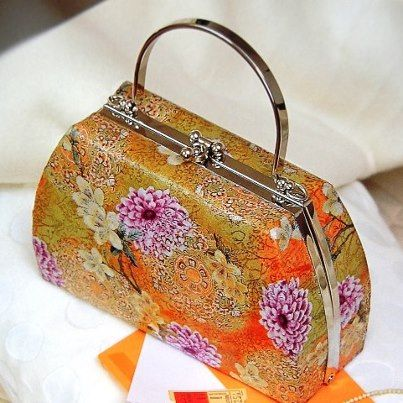 Revamp a handbag using decoupage/Decopatch paper.