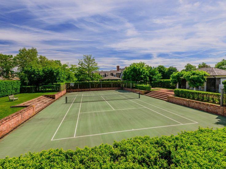 Rebound ace tennis court, sunken to reduce gate ht