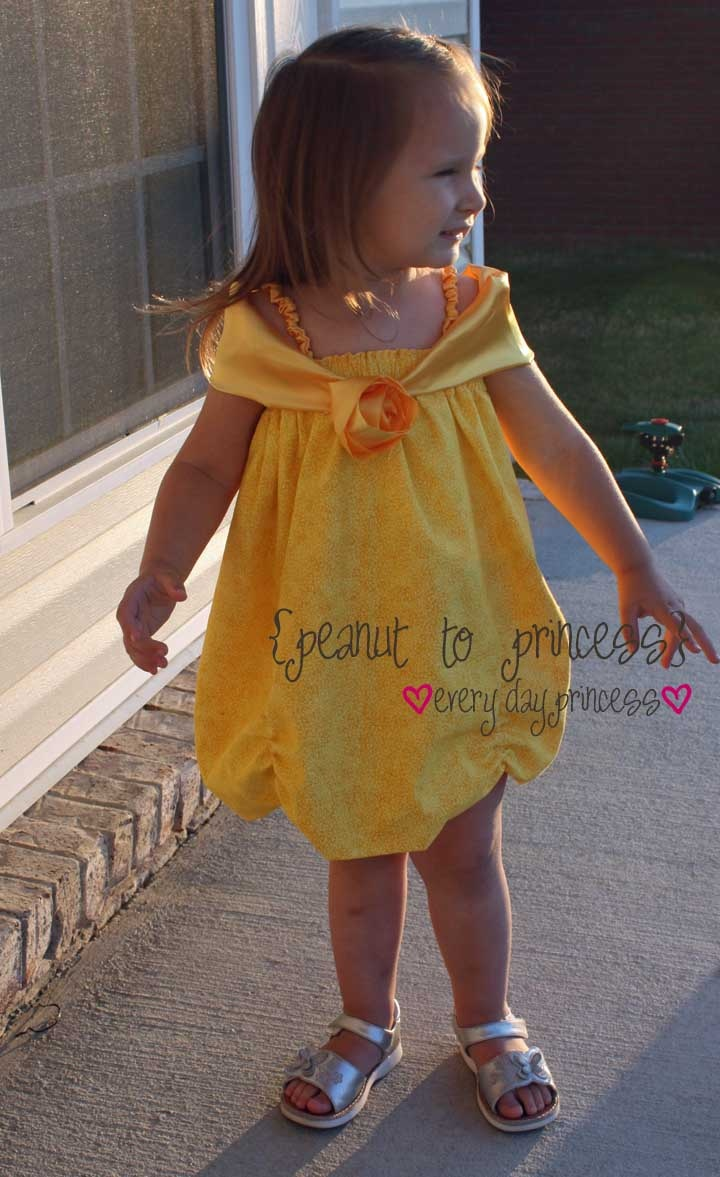 (No tutorial) Disney Princess Belle Dress. mb! says: How about wide straps through the top like a pillowcase dress? Run gathering stitches up the hem line for the ruffle.