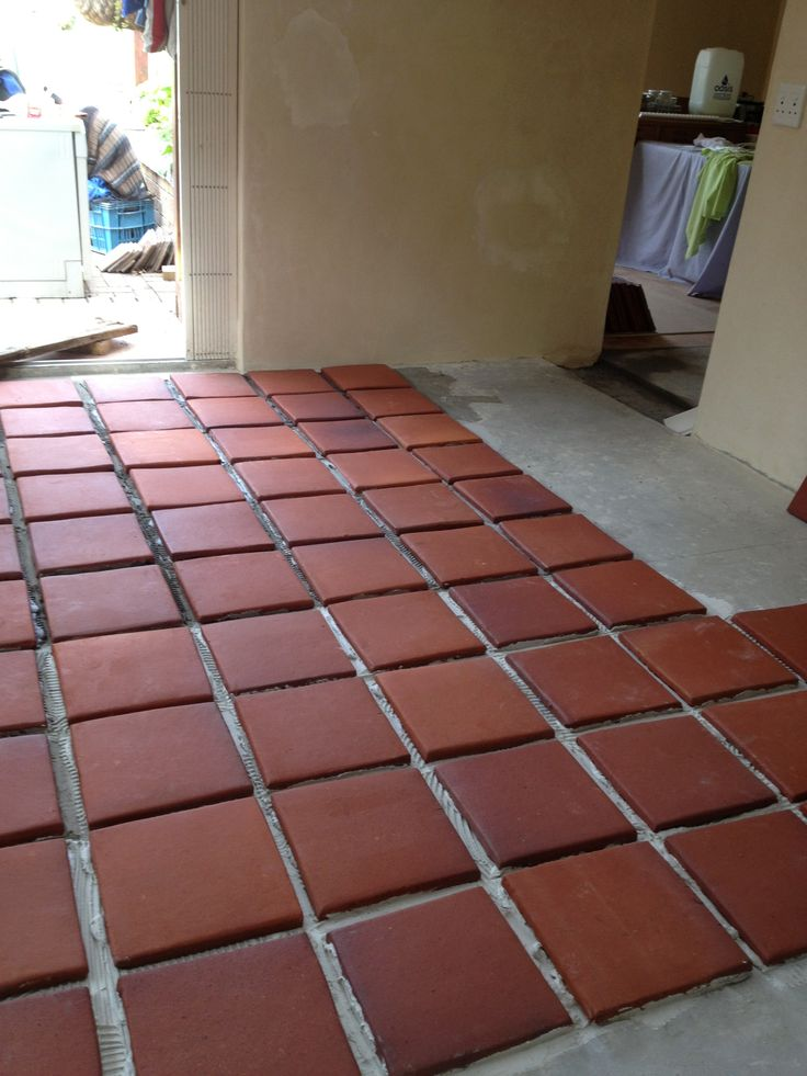 Hand made terracotta tiles laid and not to be walked on while setting - 3 days.