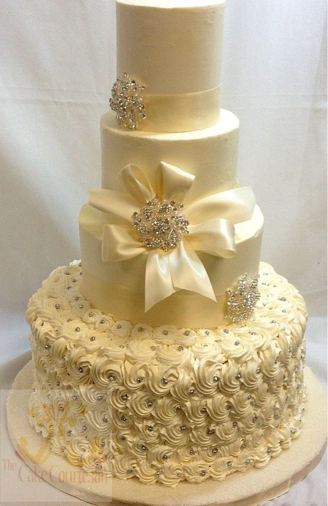 All buttercream design with rosettes and sparkles.  The Cake Courtesan