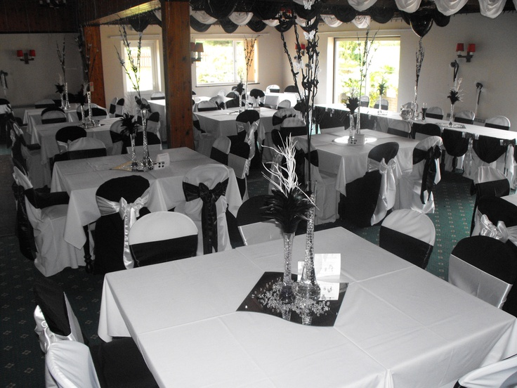 Alternating Black and White Chair Covers with Black and White Satin Bows