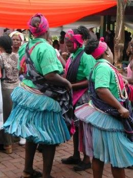 """The Tsonga People of South Africa perform a traditional dance wearing their """"Motjeka"""" skirts"""