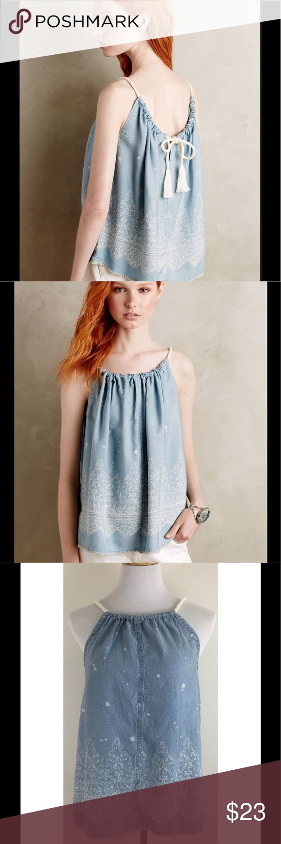 """Anthropologie Holding Horses Chambray Tank Top Anthropologie Holding Horses Amalfi Chambray Tank Top Denim Frayed Hem Sz Small  Super cute tank top with open back top part that can be tied in a knot or bow with the frayed tassel rope tie Front & back of neckline are gathered Intentionally distressed with bleach marks and raw edged frayed hem Excellent, gently used condition - no flaws noted Approximate measurements (please check measurements to insure a proper fit): Chest 19"""" across, laid…"""