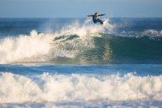 James Murphy revels in fun autumn waves at St Kilda, Dunedin, New Zealand.