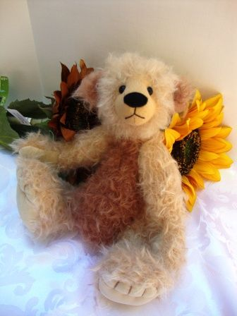 I am pleased to introduce Nico, a distinctive teddy bear with rather large feet that allow him to stand and display a variety of poses.    He is 12 inches (30cm) tall and is made from Steiff-Schulte German mohair in a light gold and milk chocolate colour.