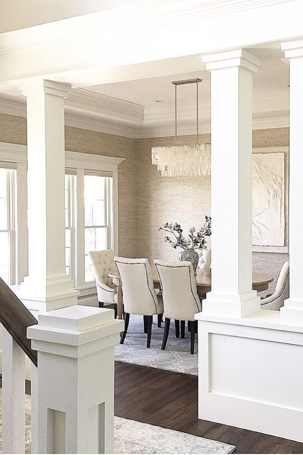 @carolineondesign Dining room. Interior columns. Benjamin Moore White Dove. West Elm Capiz chandelier. Frank Gallo. Seabrook grasscloth wall covering.