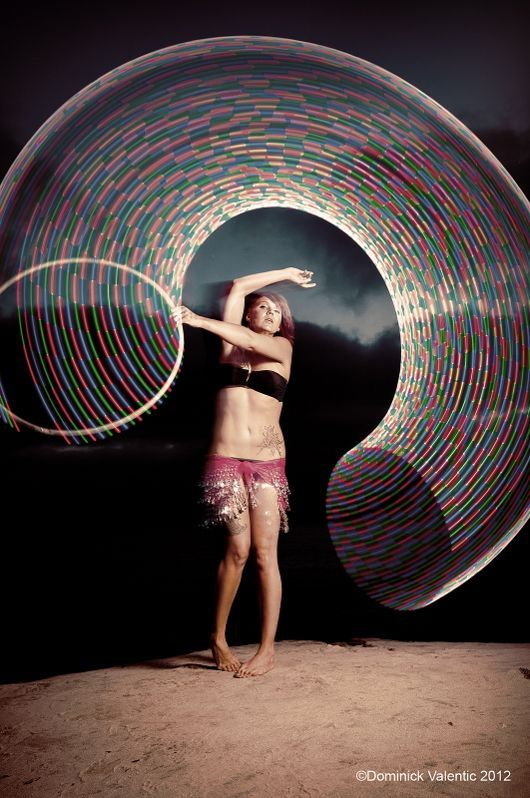SeaStar, aka Lori Gately, spins her LED hoop during a photo shoot at La Jolla Cove in San Diego, California, USA. Photo by Dominick Valentic. A http://Hooping.org Photo of the Day.