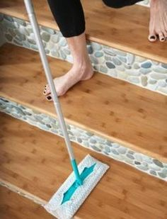 Bamboo-flooring-with sea green and white pebble tile stair backsplash. https://www.pebbletileshop.com/products/Sea-Green-and-White-Pebble-Tile.html#.VOumNPnF-1U