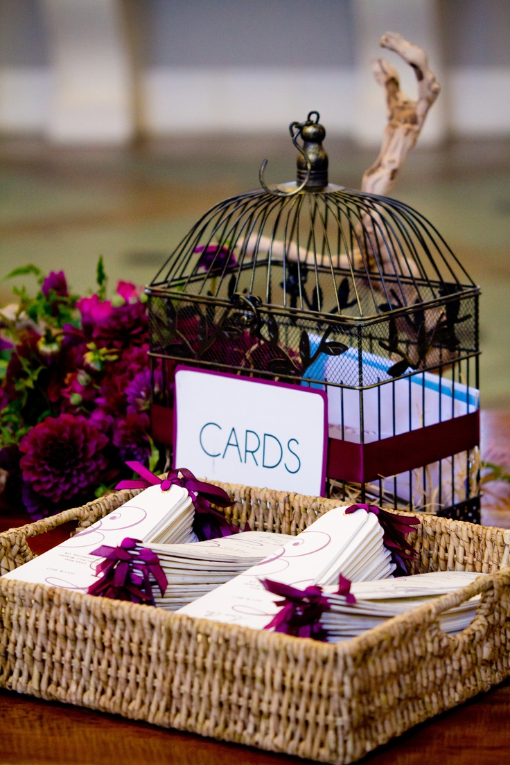 Handmade wedding ceremony program fans (foreground) & wedding cards birdcage with DIY sign (background)