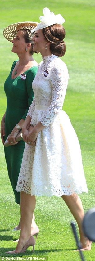 Kate strolls through the parade ring with Sophie Wessex with whom she shared a carriage during the procession at Ascot