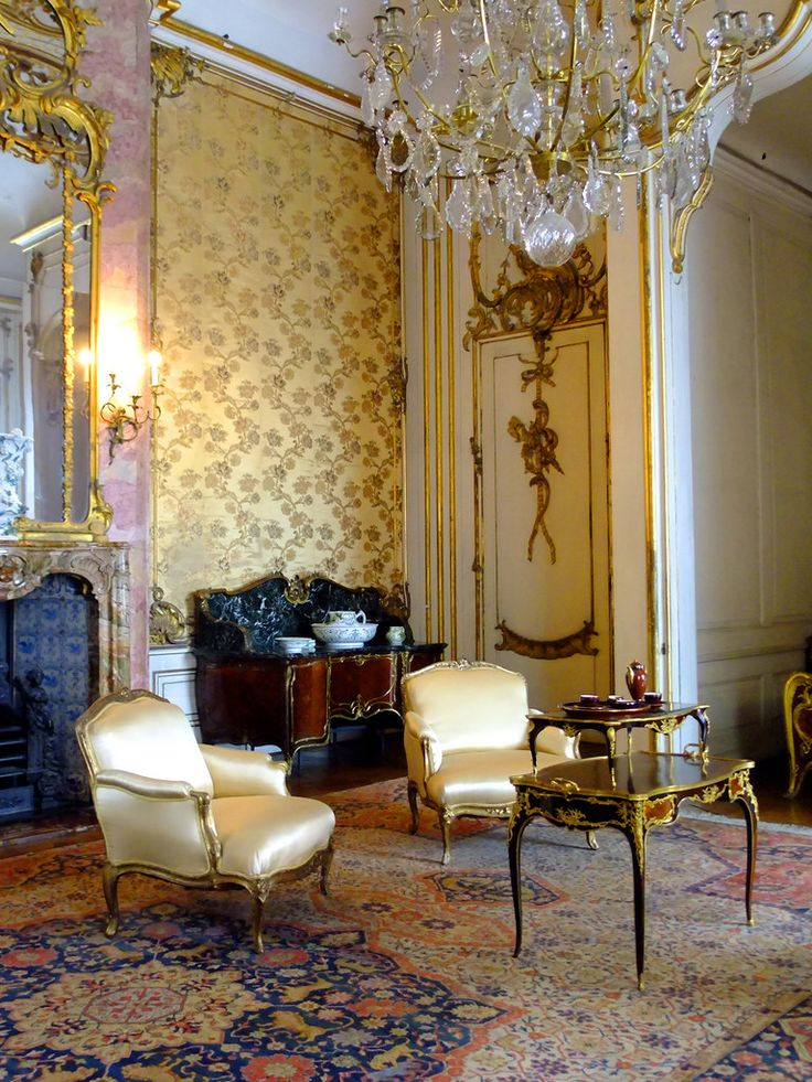 Baroque Style - This space is accessorized with the chandelier, gold  detailing, floral patterns