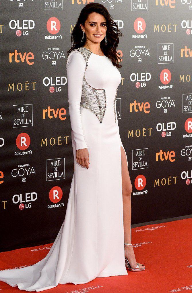 Penelope Cruz in a white long-sleeve dress