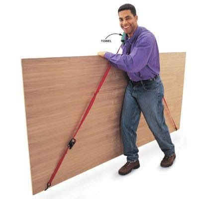 Tie down strap to easily carry plywood