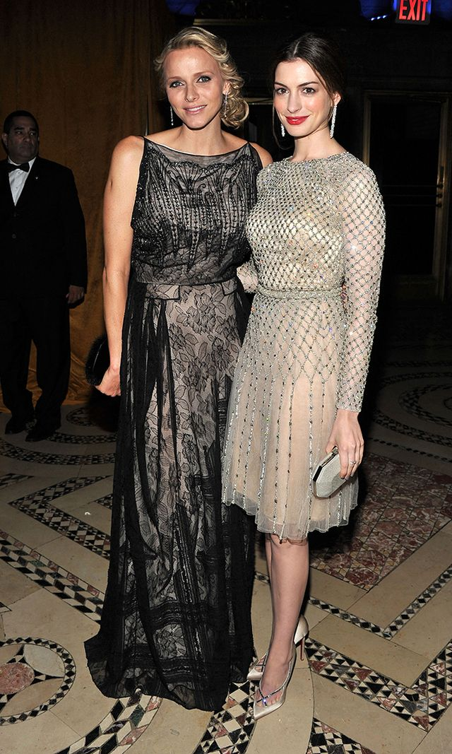 "Princess of Monaco, meet the Princess of Genovia (aka. Annne Hathaway)! The two ""princesses"" attended the 2011 Princess Grace awards looking very regal indeed, with Charlene in a lace number and Anne in a glitzy cocktail dress."