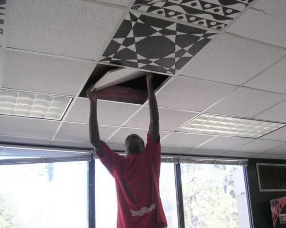 Tile In School : James keys removes a piece of ceiling tile to paint