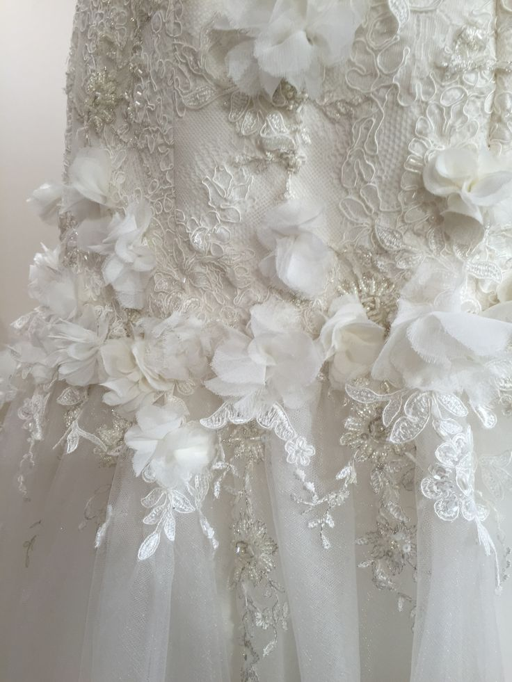 the hand appliqué lace, beading and hand made silk chiffon flowers added so much texture to this Couture gown. a stunning one off wedding dress for such a special bride #lace #weddingdressdetail #weddingdressdesigner #weddingdressnz #nz #weddingnz #purenzweddings #laceandtulleweddingdress #laceapplique