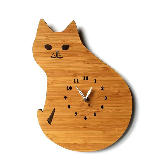 This Wood wall clock is shaped in lovely cat and make the perfect finishing touch for any habitat.  - Size: 9 W x 0.75 D x 12 H inches - Eco-friendly 3ply bamboo - Lovingly sanded and finished with natural oil. - Kid friendly numbered clock face - White hour and minute hands - Silent Clock Mechanism - Hanger on the back - Requires one AA battery to operate (not included) - Ships well protected  Because of the nature of bamboo, grains and color will be different from the pictures shown…