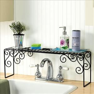 """Kitchen Sink Organizer $12.98 Increase storage, organize food prep and cleaning necessities, add a polished look to your kitchen! Durable shelf is wide enough to span double sinks, tall enough to fit over faucets. Ideal for soaps, lotions, sponges, stopper, ring holders and plants. Rust-resistant finish.    42"""" x 7"""" x 9"""" H"""