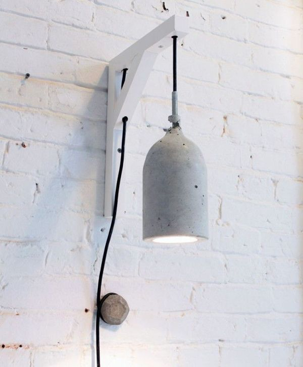 DIY Concrete Lamps   How To Use Plastic Bottles To Make Concrete Pendant  Lamps Via Brit + Co.