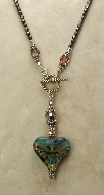 Pendant hanging from toggle clasp. Very nice: