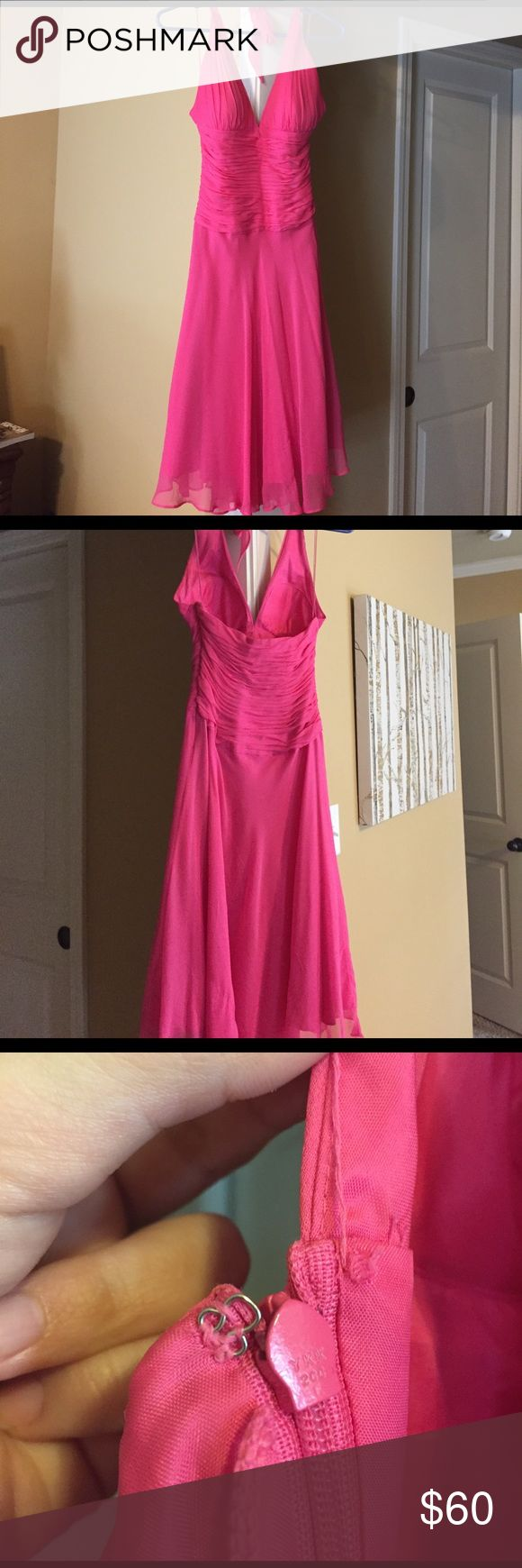 Pink halter dress Worn a few times. Hot pink hits right above knee. Only flaw is seen in 3rd pic. The hook closer is missing. Still zips properly. The missing closer is hidden under the arm so when zipped you cannot tell. Padded top. Cache Dresses